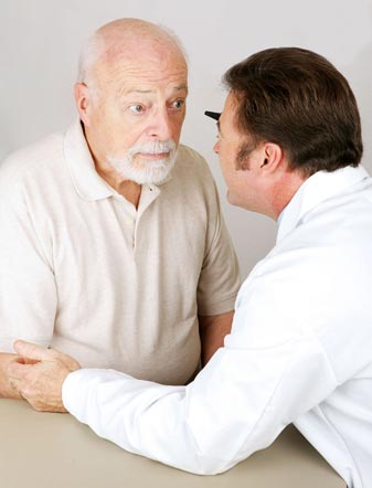 Patient having eyes inspected by visiting optician